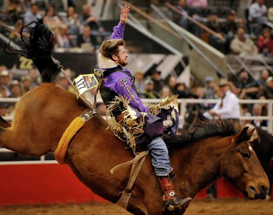 Tilden Hooper rides during the bareback competition of the San Antonio rodeo on Friday, Feb. 7, 2014, at the AT&T Center. (Darren Abate/For the Express-News) Photo: Darren Abate, Darren Abate/Express-News