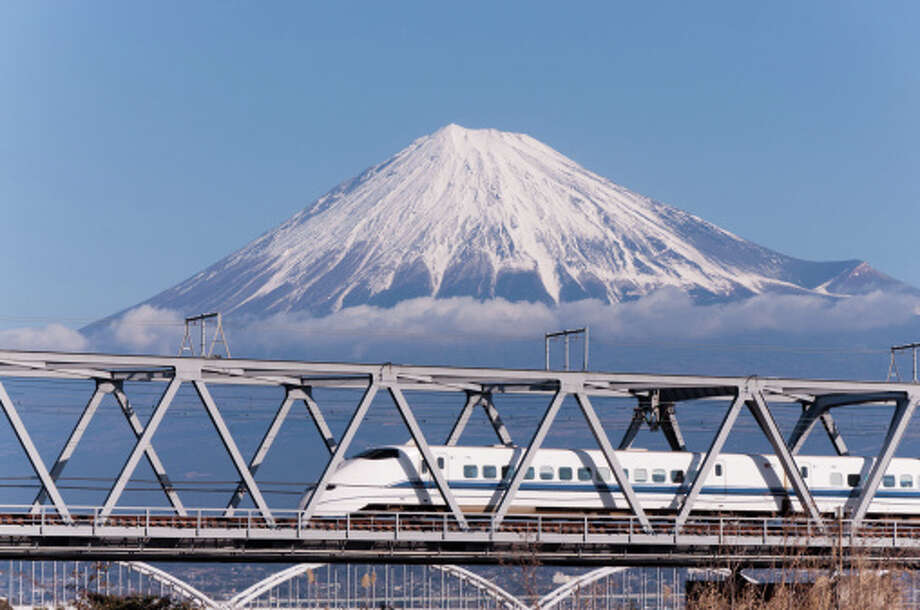 A Shinkansen train and Mt. Fuji. Photo: GenPi Photo, Getty Images/Flickr RM / Flickr RM