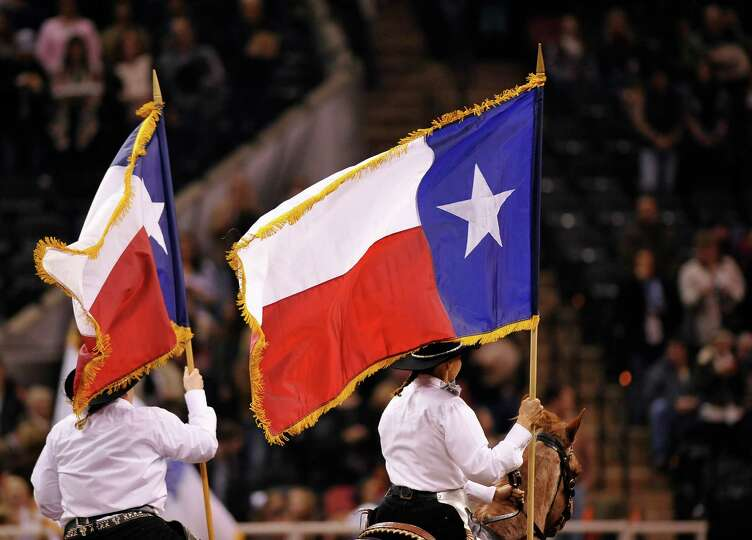 Members of the Bexar County Palomino Drill Team perform during the opening ceremony of the San Anton