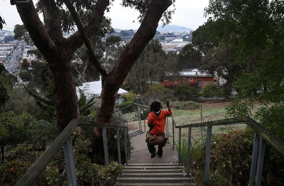 Jamal Kile, 11, races his younger brother down the Joy Street stairs on their way home in Bernal Heights. Photo: Leah Millis, The Chronicle