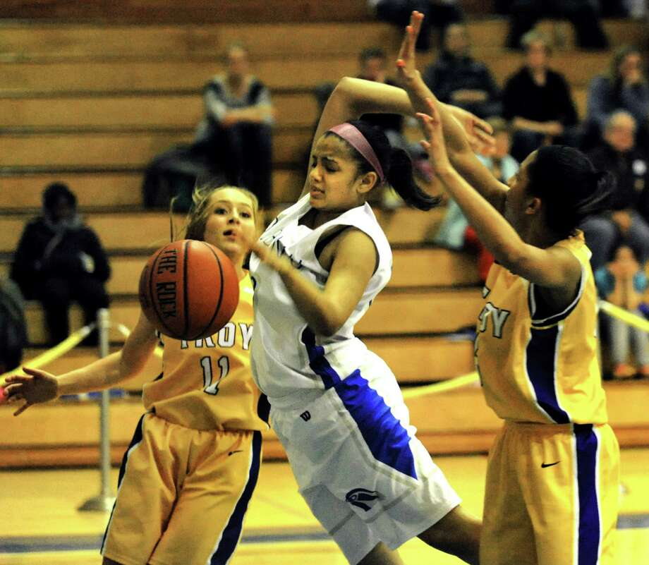 Albany'sKiersten Gordon, center, loses the ball   against Troy's Arianna Judge, left, and Shalie Frierson on Friday, Feb. 7, 2014, at Albany High in Albany, N.Y.  (Cindy Schultz / Times Union) Photo: Cindy Schultz / 00025676A