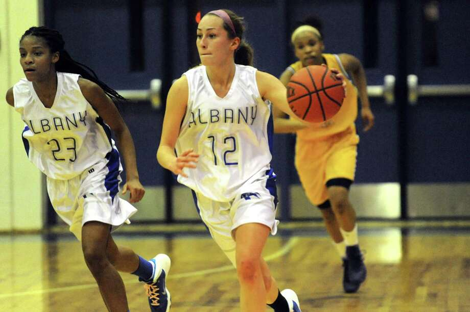 Albany's Cara Waterson, center, flanked by Mylah Chandler, left, drives up court during their basketball game against Troy on Friday, Feb. 7, 2014, at Albany High in Albany, N.Y.  (Cindy Schultz / Times Union) Photo: Cindy Schultz / 00025676A