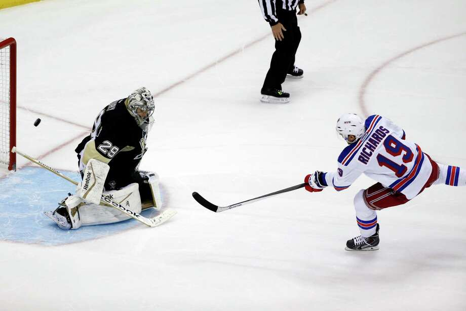 New York Rangers' Brad Richards (19) gets the game-winning, shootout goal past Pittsburgh Penguins goalie Marc-Andre Fleury (29) during an NHL hockey game between the Pittsburgh Penguins and the New York Rangers in Pittsburgh, Friday, Feb. 7, 2014. The Rangers won 4-3. (AP Photo/Gene J. Puskar) ORG XMIT: PAGP111 Photo: Gene J. Puskar / AP