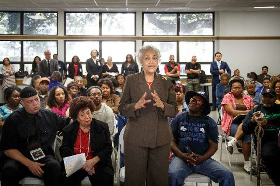 "Former postmaster Jacqueline Bostic, who served the U.S. Postal Service for 32 years, speaks during Congresswoman Sheila Jackson Lee's Town Hall Meeting to ""Save Our Post Offices"" on Jan. 11, 2014 in Houston. (Michael Paulsen 
