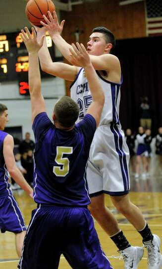 CCHS's Anthony Mack, right, shoots for the hoop as CBA's Nick Marini defends during their basketball