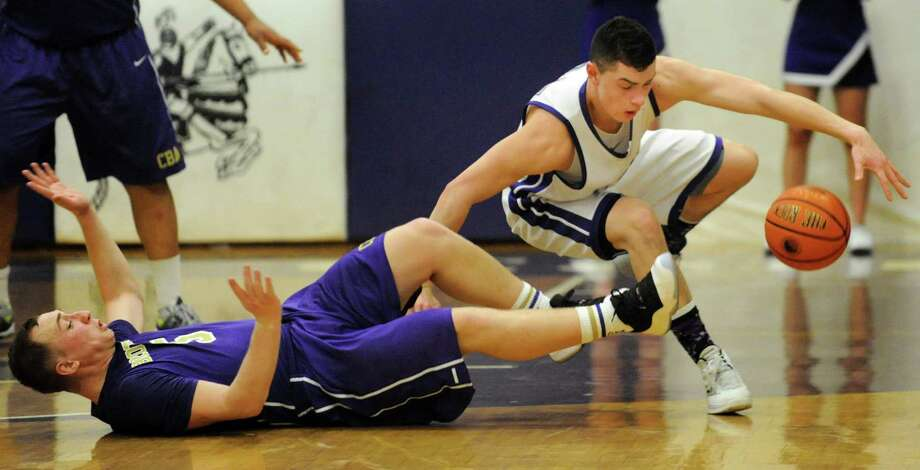 CCHS's Anthony Mack, right, chases a loose ball from CBA's Nick Marini during their basketball game on Friday, Feb. 7, 2014, at Catholic Central High in Troy, N.Y.  (Cindy Schultz / Times Union) Photo: Cindy Schultz / 00025677A