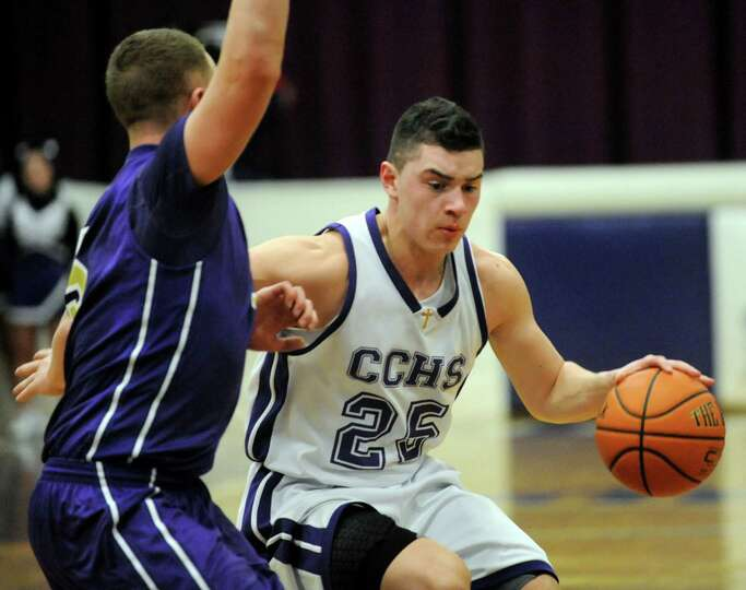 CCHS's Anthony Mack, right, controls the ball a CBA's Nick Marini defends during their basketball ga