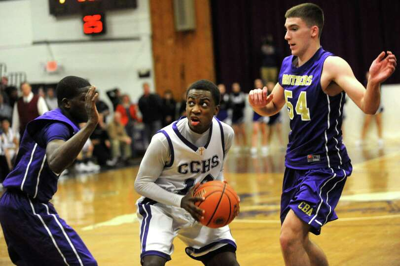 CCHS's Jiriem Tedder, center, looks to shoot as CBA's Dan Owens, left, and Greig Stire defend during