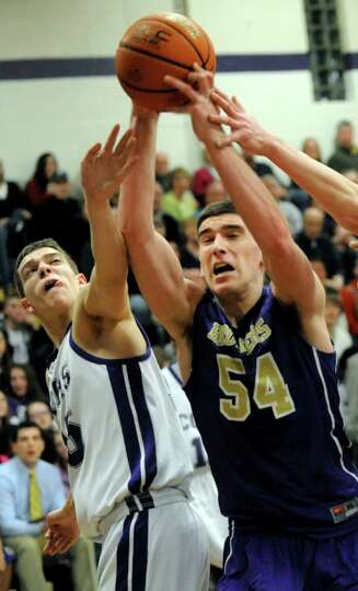 CBA's Greig Stire, right, battles for a rebound against CCHS's Christian Englund during their basket