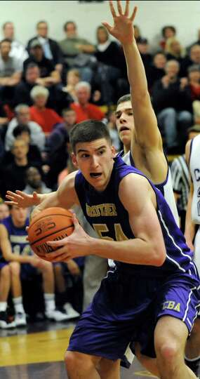 CBA's Greig Stire, left, wins the rebound against CCHS's Christian Englund during their basketball g