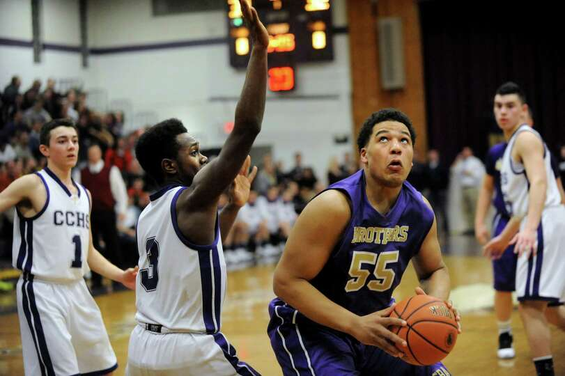 CBA's Brian Renauld, right, looks to the hoop as CCHS's Brian Brooks defends during their basketball
