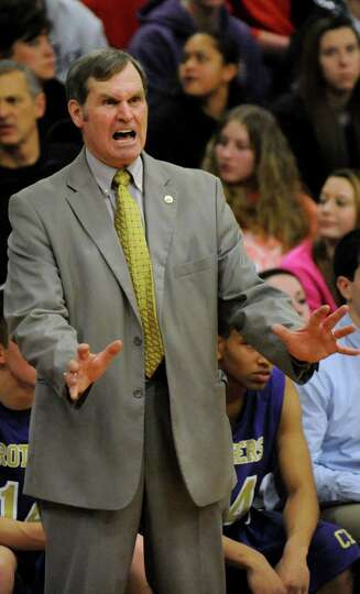 CBA's coach Dave Doemel instructs his team during their basketball game on Friday, Feb. 7, 2014, at