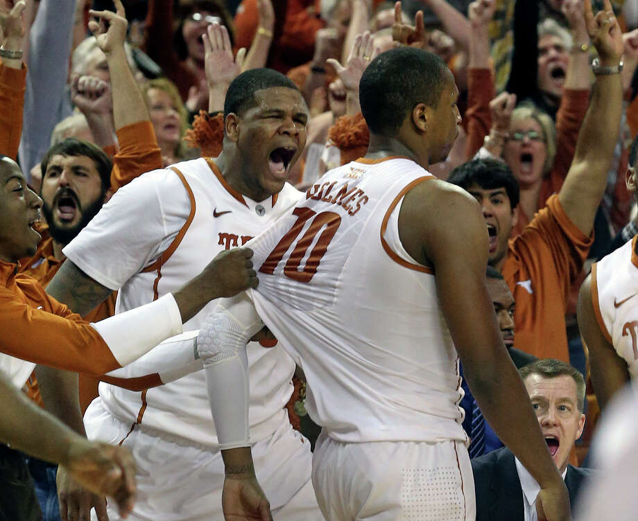 Longhorn center Cameron Ridley screams along with fans as Johnathan Holmes turns and walks off the court after hitting a buzzer beating three pointer to give his team a 67-64 win as UT hosts Kansas State at the Erwin Center in Austin on January 21, 2014. Photo: For The San Antonio Express-News