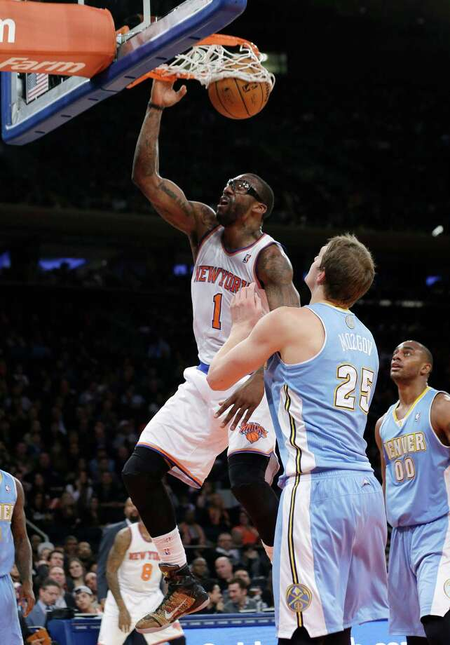 New York Knicks' Amare Stoudemire (1) dunks in front of Denver Nuggets' Timofey Mozgov (25), of Russia, during the first half of an NBA basketball game Friday, Feb. 7, 2014, in New York. The Knicks won 117-90. (AP Photo/Frank Franklin II) ORG XMIT: MSG112 Photo: Frank Franklin II / AP