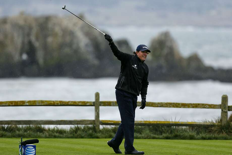 Phil Mickelson signals a fore right off the 18th tee at Pebble Beach Golf Links during round 2 of the Pebble Beach National Pro-Am golf tournament on Friday Feb. 7, 2014, in Pebble Beach, Calif. Photo: Michael Macor, The Chronicle
