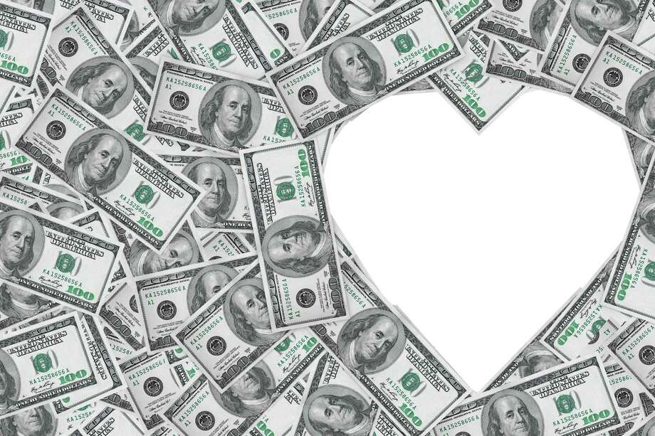 Hundred dollar bills making a heart symbol on a white background Photo: Alexander Kharchenko, Hundred Dollar Bills Making A He / doomu - Fotolia