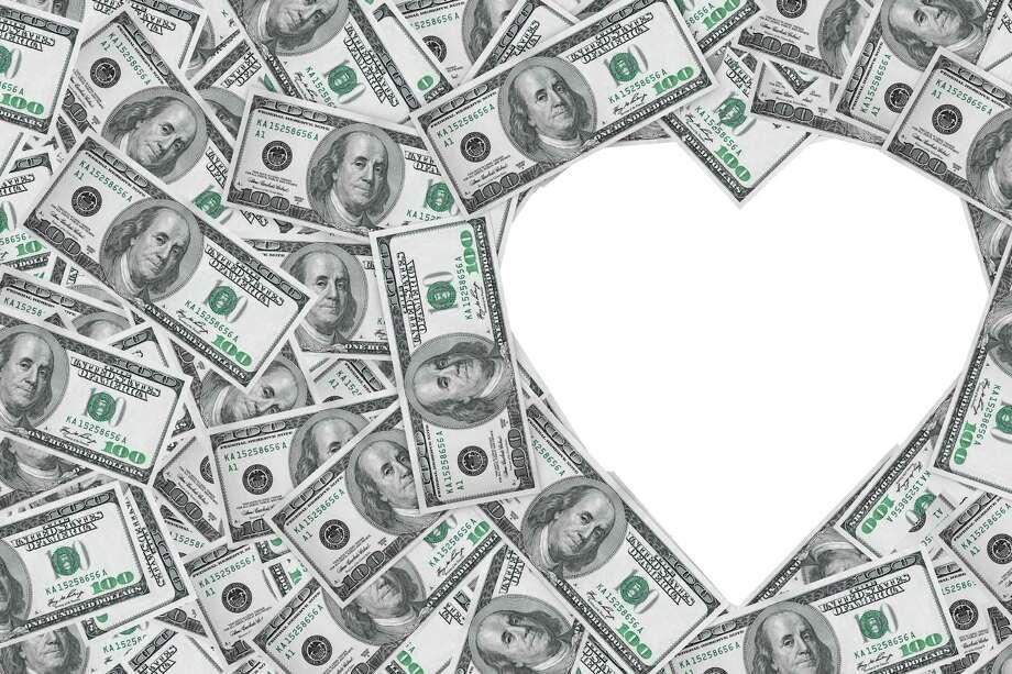 Hundred dollar bills making a heart symbol on a white background Photo: Alexander Kharchenko, Hundred Dollar Bills Making A He / doomu - Fotolia