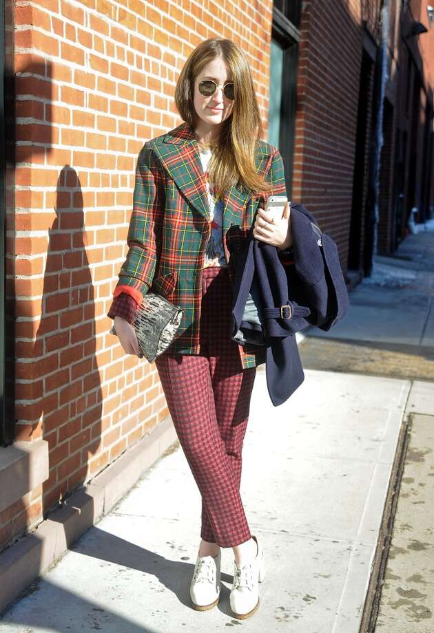 Charlotte Fassler is seen outside the Duckie Brown show wearing a vintage shirt, vintage jacket, Top Shop pants and shoes, J. Crew coat and Alexander Wang clutch on February 6, 2014 in New York City.  (Photo by Daniel Zuchnik/Getty Images) Photo: Daniel Zuchnik, Getty Images