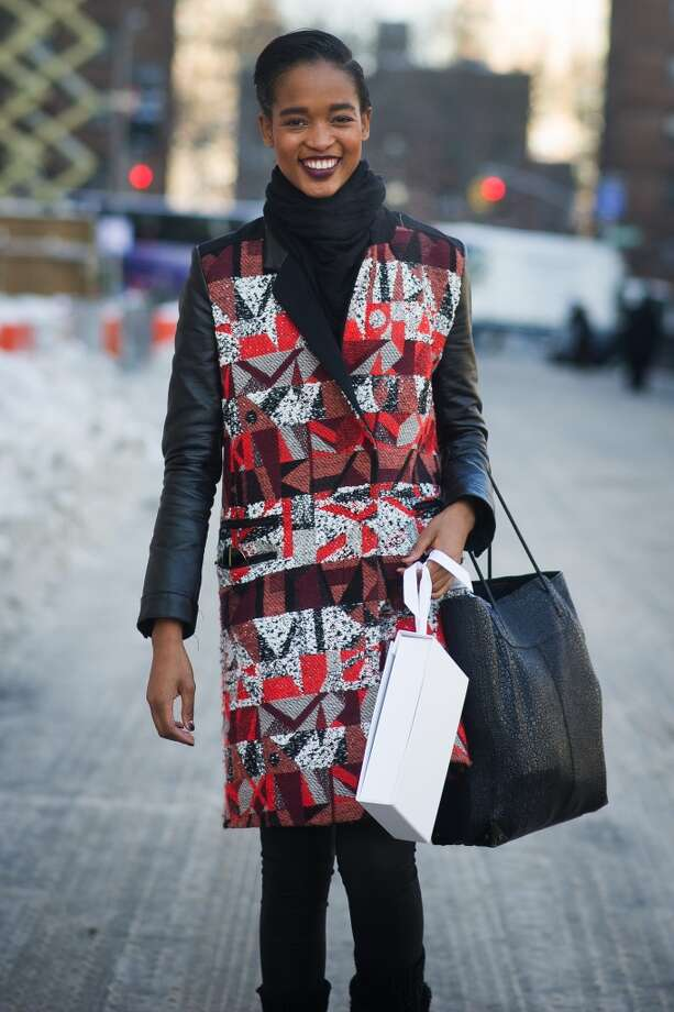 Model Marihenny Rivera Passible is wearing a coat from Cretures of the Wind NYMM on the streets of Manhattan on February 7, 2014 in New York City.  (Photo by Timur Emek/Getty Images) Photo: Timur Emek, Getty Images