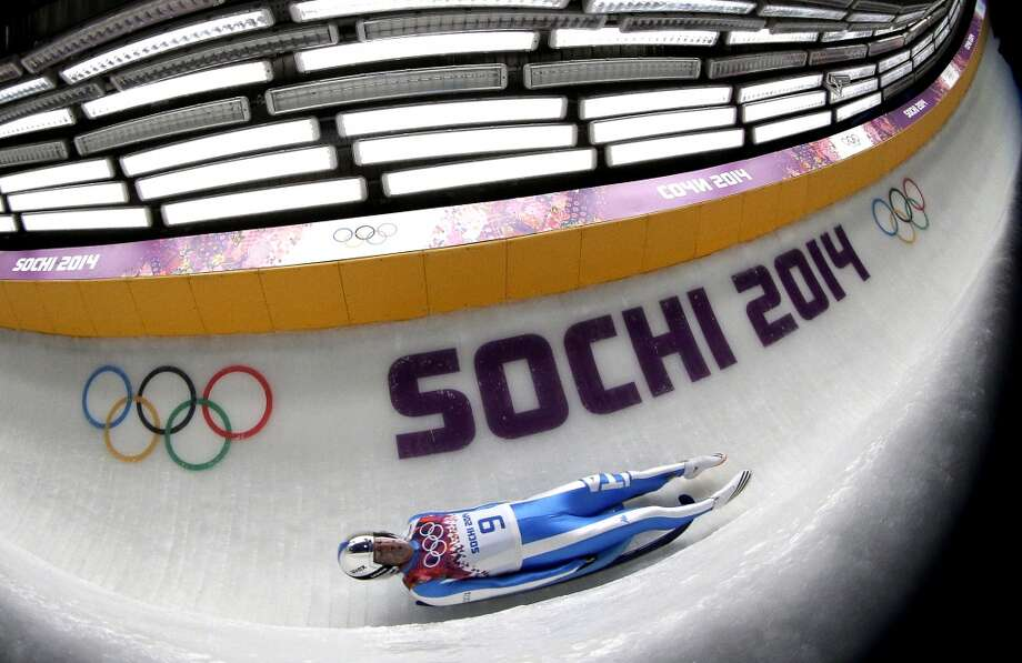 Armin Zoeggeler from Italy takes a turn during the first heat of the men's singles luge competition at the 2014 Winter Olympics, Saturday, Feb. 8, 2014, in Krasnaya Polyana, Russia. (AP Photo/Michael Sohn) Photo: Michael Sohn, Associated Press