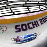 Armin Zoeggeler from Italy takes a turn during the first heat of the men's singles luge competition at the 2014 Winter Olympics, Saturday, Feb. 8, 2014, in Krasnaya Polyana, Russia. (AP Photo/Michael Sohn)
