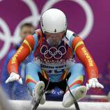 Bogdan Macovei of the Republic of Moldova competes during the men's singles luge competition at the 2014 Winter Olympics, Saturday, Feb. 8, 2014, in Krasnaya Polyana, Russia. (AP Photo/Natacha Pisarenko)