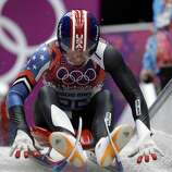 Tucker West of the United States competes during the men's singles luge competition at the 2014 Winter Olympics, Saturday, Feb. 8, 2014, in Krasnaya Polyana, Russia. (AP Photo/Natacha Pisarenko)