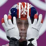 Aidan Kelly of the United States prepares for his first run during the men's singles luge competition at the 2014 Winter Olympics, Saturday, Feb. 8, 2014, in Krasnaya Polyana, Russia. (AP Photo/Natacha Pisarenko)