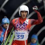 Lien Te-An of Taiwan waves to crowd after a rough first run during the men's singles luge competition at the 2014 Winter Olympics, Saturday, Feb. 8, 2014, in Krasnaya Polyana, Russia. (AP Photo/Dita Alangkara)