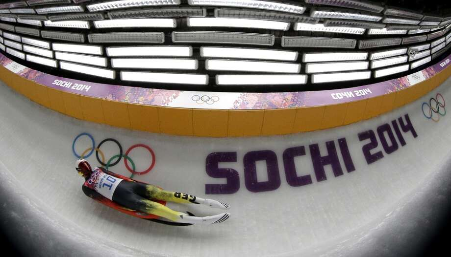 Felix Loch from Germany takes a turn during the first heat of the men's singles luge competition at the 2014 Winter Olympics, Saturday, Feb. 8, 2014, in Krasnaya Polyana, Russia. (AP Photo/Michael Sohn) Photo: Michael Sohn, Associated Press
