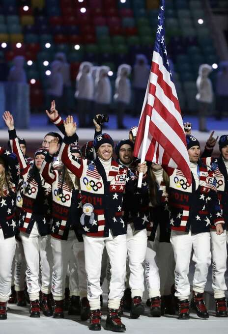 Todd Lodwick of the United States carries the national flag as he leads the team during the opening ceremony of the 2014 Winter Olympics in Sochi, Russia, Friday, Feb. 7, 2014. (AP Photo/Mark Humphrey) Photo: Mark Humphrey, Associated Press