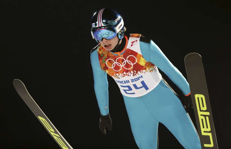 Finland's Olli  Muotka makes an attempt during the men's normal hill ski jumping qualification at the 2014 Winter Olympics, Saturday, Feb. 8, 2014, in Krasnaya Polyana, Russia. (AP Photo/Matthias Schrader) Photo: Matthias Schrader, Associated Press