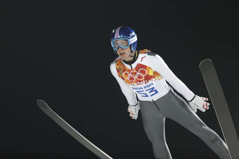 Austria's Thomas Diethart makes an attempt during the men's normal hill ski jumping qualification at the 2014 Winter Olympics, Saturday, Feb. 8, 2014, in Krasnaya Polyana, Russia. (AP Photo/Matthias Schrader) Photo: Matthias Schrader, Associated Press