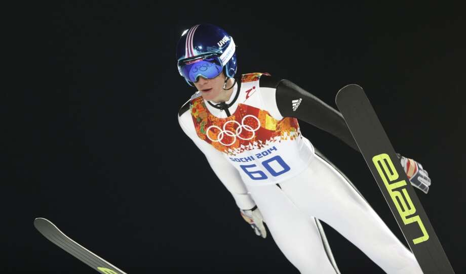 Slovenia's Peter Prevc makes an attempt during the men's normal hill ski jumping qualification at the 2014 Winter Olympics, Saturday, Feb. 8, 2014, in Krasnaya Polyana, Russia. (AP Photo/Matthias Schrader) Photo: Matthias Schrader, Associated Press
