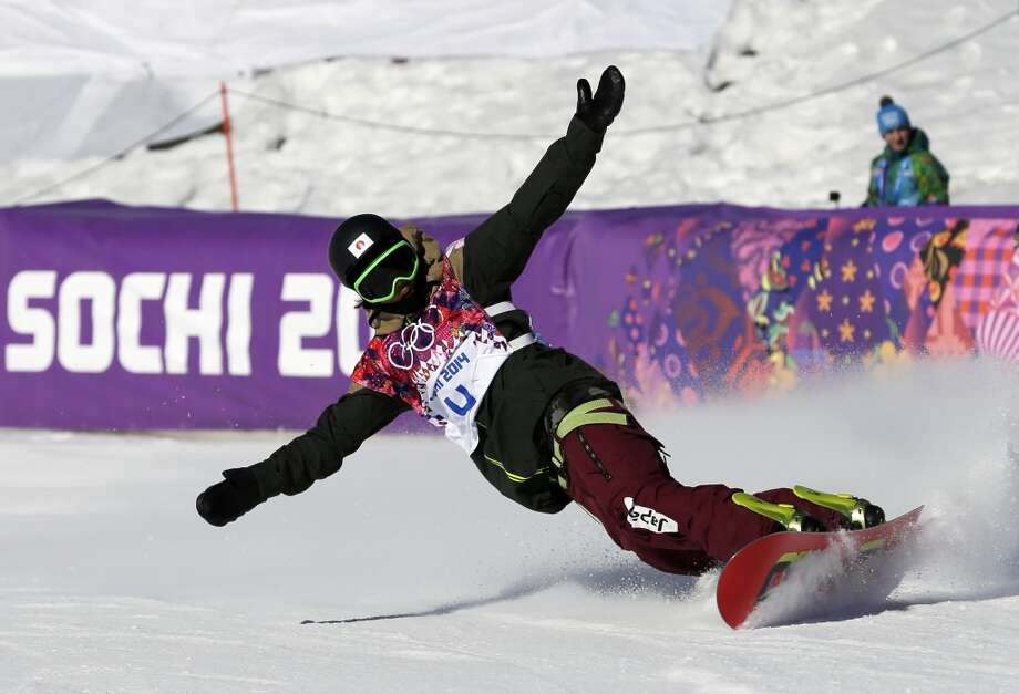 Japan's Yuki Kadono reacts as he finishes a run during the men's snowboard slopestyle final at the Rosa Khutor Extreme Park, at the 2014 Winter Olympics, Saturday, Feb. 8, 2014, in Krasnaya Polyana, Russia. (AP Photo/Andy Wong) Photo: Andy Wong, Associated Press