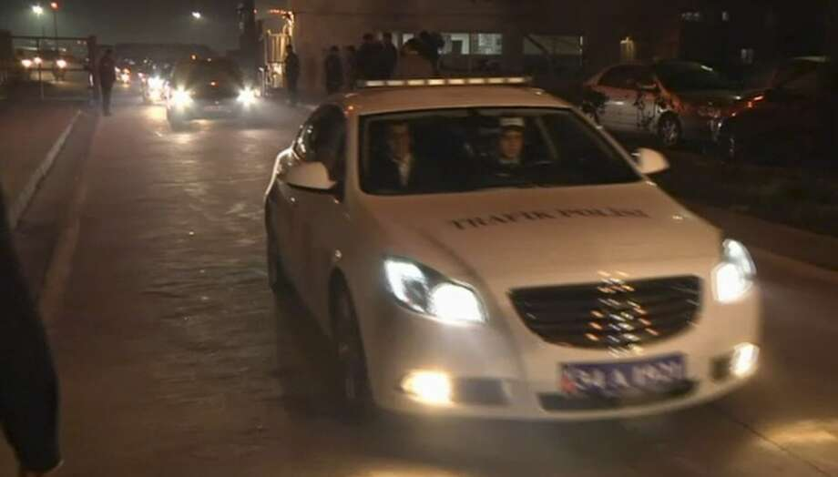 """In this image from TV, a police vehicle carrying Huseyin Avni Mutlu, the Istanbul governor, leads a convoy of cars believed to be carrying released passengers who were held hostage aboard a plane, Friday Feb. 7, 2014. All 110 passengers aboard the plane were evacuated """"without any problems"""" after authorities subdued a man who attempted to hijack a Turkish plane to Sochi, Russia. (AP Photo / APTN) TV OUT Photo: Associated Press"""