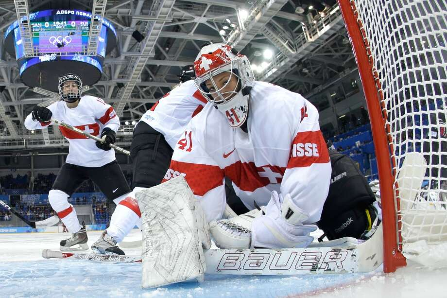 SOCHI, - - FEBRUARY 08:  Florence Schelling #41 of Switzerland looks on after a play against Canada during the Women's Ice Hockey Preliminary Round Group A Game on day 1 of the Sochi 2014 Winter Olympics at Shayba Arena on February 8, 2014 in Sochi, Russia.  (Photo by Pool/Getty Images) Photo: Getty Images