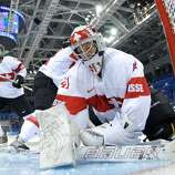 SOCHI, - - FEBRUARY 08:  Florence Schelling #41 of Switzerland looks on after a play against Canada during the Women's Ice Hockey Preliminary Round Group A Game on day 1 of the Sochi 2014 Winter Olympics at Shayba Arena on February 8, 2014 in Sochi, Russia.  (Photo by Pool/Getty Images)