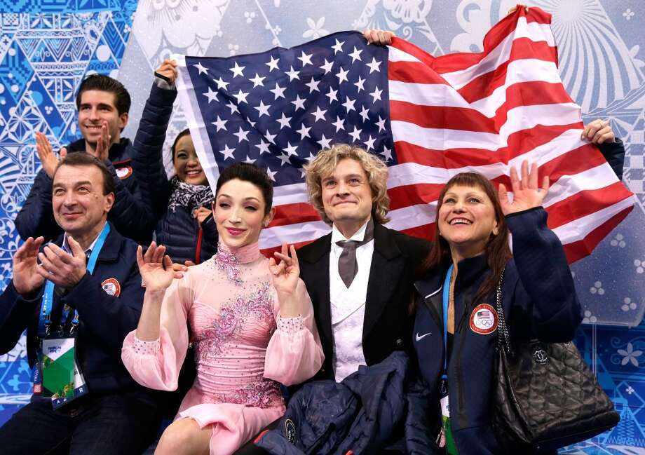 SOCHI, RUSSIA - FEBRUARY 08:  Meryl Davis and Charlie White of the United States wait for their score with teammates and coaches during the Figure Skating Team Ice Dance - Short Dance during day one of the Sochi 2014 Winter Olympics at Iceberg Skating Palace on February 8, 2014 in Sochi, Russia.  (Photo by Darren Cummings/Pool/Getty Images) Photo: Getty Images