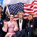 SOCHI, RUSSIA - FEBRUARY 08:  Meryl Davis and Charlie White of the United States wait for their score with teammates and coaches during the Figure Skating Team Ice Dance - Short Dance during day one of the Sochi 2014 Winter Olympics at Iceberg Skating Palace on February 8, 2014 in Sochi, Russia.  (Photo by Darren Cummings/Pool/Getty Images)