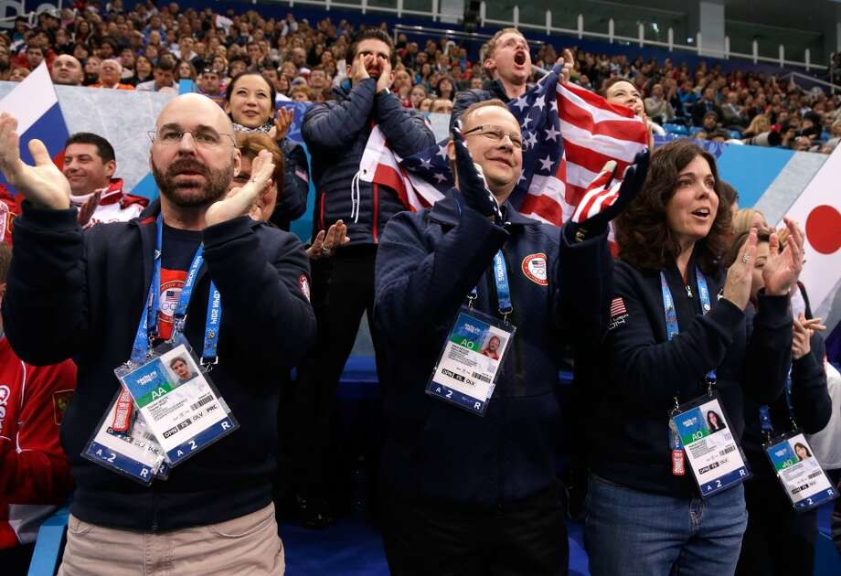 SOCHI, RUSSIA - FEBRUARY 08: The United States figure skating team and coaches cheer as Meryl Davis and Charlie White of the United States compete in the Figure Skating Team Ice Dance - Short Dance during day one of the Sochi 2014 Winter Olympics at Iceberg Skating Palace on February 8, 2014 in Sochi, Russia.  (Photo by Pool Pool/Getty Images) Photo: Getty Images