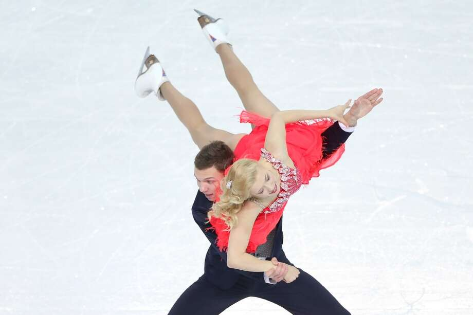 SOCHI, RUSSIA - FEBRUARY 08:  Ekaterina Bobrova and Dmitri Soloviev of Russia compete in the Figure Skating Team Ice Dance - Short Dance during day one of the Sochi 2014 Winter Olympics at Iceberg Skating Palace on February 8, 2014 in Sochi, Russia.  (Photo by Matthew Stockman/Getty Images) Photo: Getty Images