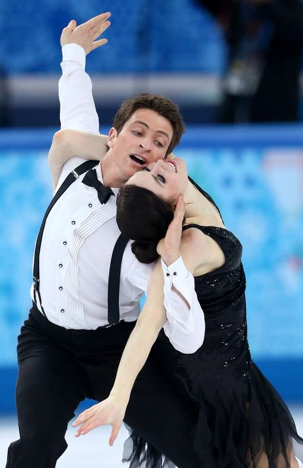 SOCHI, RUSSIA - FEBRUARY 08:  Tessa Virtue and Scott Moir of Canada compete in the Figure Skating Team Ice Dance - Short Dance during day one of the Sochi 2014 Winter Olympics at Iceberg Skating Palace on February 8, 2014 in Sochi, Russia.  (Photo by Streeter Lecka/Getty Images) Photo: Getty Images