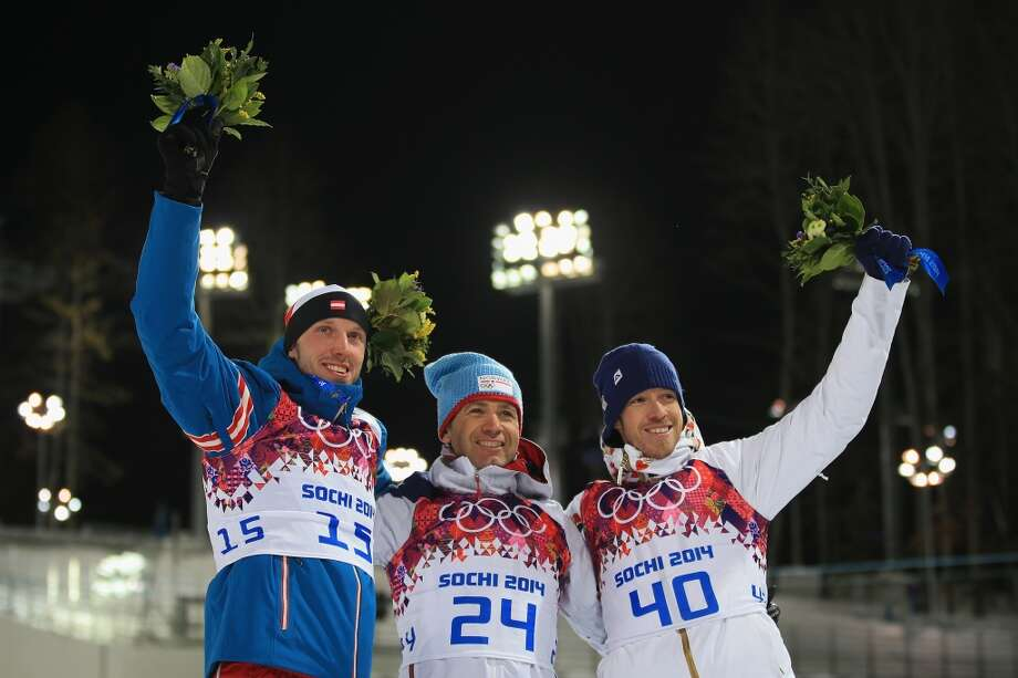 SOCHI, RUSSIA - FEBRUARY 08: Gold medalist Ole Einar Bjoerndalen (C) of Norway, silver medallist Dominik Landertinger of Austria (L) and bronze medallist Jaroslav Soukup of the Czech Republic competes in the Men's Sprint 10 km during day one of the Sochi 2014 Winter Olympics at Laura Cross-country Ski & Biathlon Center on February 8, 2014 in Sochi, Russia.  (Photo by Richard Heathcote/Getty Images) Photo: Getty Images