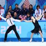 SOCHI, RUSSIA - FEBRUARY 08:  Tessa Virtue and Scott Moir of Canada compete in the Figure Skating Team Ice Dance - Short Dance during day one of the Sochi 2014 Winter Olympics at Iceberg Skating Palace on February 8, 2014 in Sochi, Russia.  (Photo by Streeter Lecka/Getty Images)