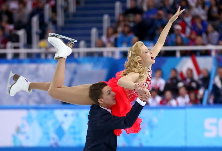 SOCHI, RUSSIA - FEBRUARY 08:  Ekaterina Bobrova and Dmitri Soloviev of Russia compete in the Figure Skating Team Ice Dance - Short Dance during day one of the Sochi 2014 Winter Olympics at Iceberg Skating Palace on February 8, 2014 in Sochi, Russia.  (Photo by Streeter Lecka/Getty Images) Photo: Getty Images