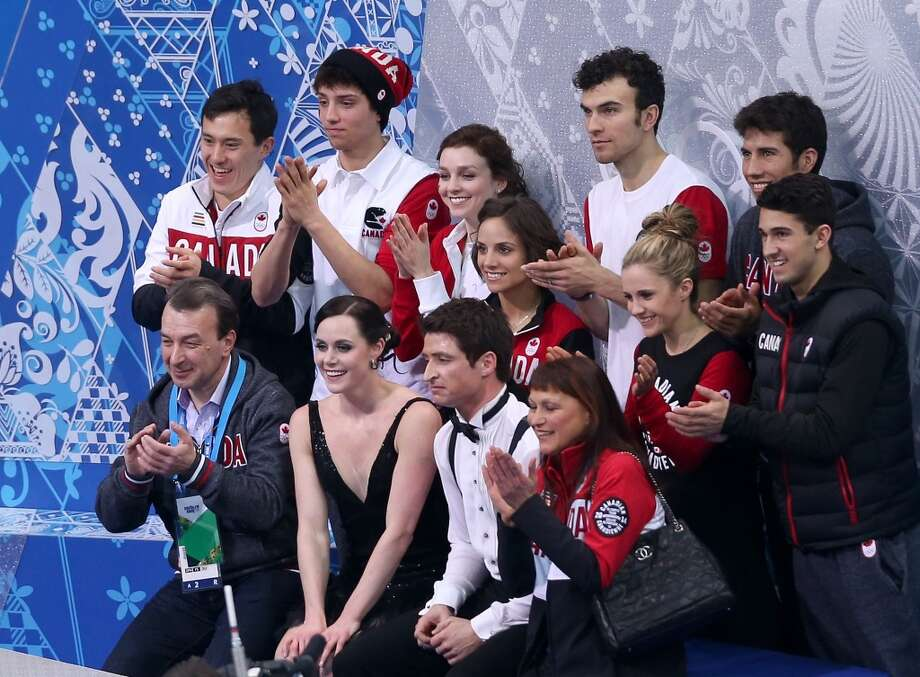 SOCHI, RUSSIA - FEBRUARY 08:  Tessa Virtue and Scott Moir of Canada wait for their score with teammates and coaches during the Figure Skating Team Ice Dance - Short Dance during day one of the Sochi 2014 Winter Olympics at Iceberg Skating Palace on February 8, 2014 in Sochi, Russia.  (Photo by Matthew Stockman/Getty Images) Photo: Getty Images