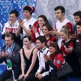 SOCHI, RUSSIA - FEBRUARY 08:  Tessa Virtue and Scott Moir of Canada wait for their score with teammates and coaches during the Figure Skating Team Ice Dance - Short Dance during day one of the Sochi 2014 Winter Olympics at Iceberg Skating Palace on February 8, 2014 in Sochi, Russia.  (Photo by Matthew Stockman/Getty Images)