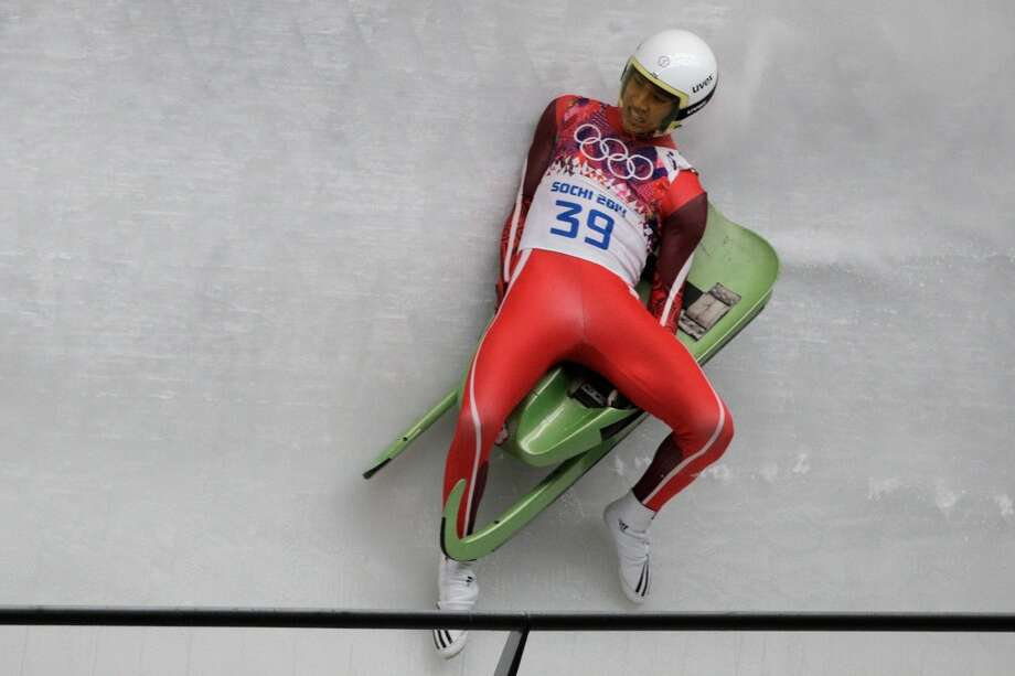 SOCHI, RUSSIA - FEBRUARY 08:  Te-An Lien of Chinese Taipei slips while making a run during the Luge Men's Singles on Day 1 of the Sochi 2014 Winter Olympics at the Sliding Center Sanki on February 8, 2014 in Sochi, Russia.  (Photo by Adam Pretty/Getty Images) Photo: Getty Images