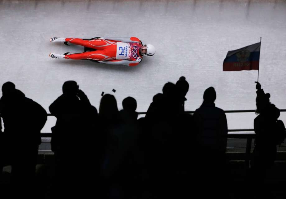 SOCHI, RUSSIA - FEBRUARY 08:  Maciej Kurowski of Poland makes a run during the Luge Men's Singles on Day 1 of the Sochi 2014 Winter Olympics at the Sliding Center Sanki on February 8, 2014 in Sochi, Russia.  (Photo by Adam Pretty/Getty Images) Photo: Getty Images